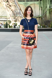 Kaya Scodelario gave her plain top a graphic punch with a striped wraparound mini skirt, also by Chanel.