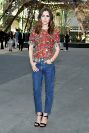 Lily Collins teamed her cute top with classic blue jeans.