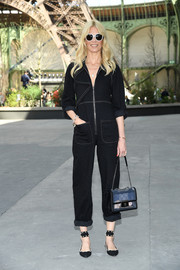 Studded black flats with broad ankle straps finished off Claudia Schiffer's outfit.