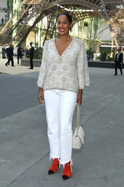 Tracee Ellis Ross kept up the laid-back feel with a pair of frayed bootcut jeans.