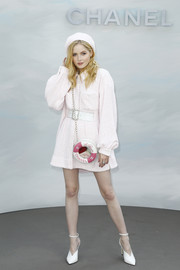 Ellie Bamber paired her dress with white ankle-strap pumps.