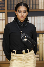 Amandla Stenberg attended the Chanel Couture Fall 2019 show carrying a quilted leather bag from the brand.