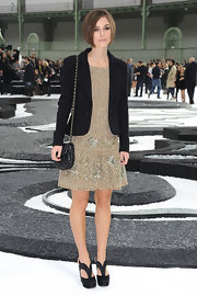 Keira showed off her platform pumps while hitting the Chanel Spring 2011 fashion show.