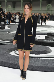 Virginie Ledouyen showed off her zip front tweed dress while attending the Chanel Spring 2011 fashion show.