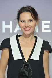 Virginie Ledoyen wore her hair casually pinned up while attending fashion week in Paris.