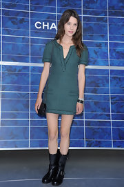 Astrid Berges-Frisbey donned a teal textured mini dress with pockets at the Chanel Spring/Summer 2013 show during Paris Fashion Week.