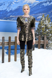 Ellie Bamber donned a graphic blouse by Chanel for the brand's Fall 2019 show.
