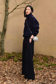 Liu Wen teamed her sweater with a pair of wide-leg nautical pants, also by Chanel.
