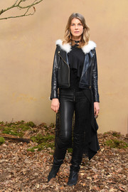 Angela Lindvall toughened a black ruffle top with a leather biker jacket for the Chanel Fall 2018 show.