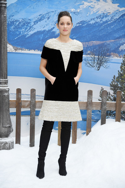 Marion Cotillard finished off her outfit with black thigh-high boots.