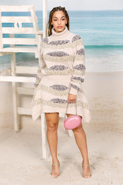 Jorja Smith bundled up in a turtleneck sweater dress by Chanel for the brand's Spring 2019 show.