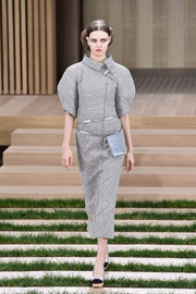 Lindsey Wixson walked the Chanel Couture runway looking futuristic in a gray tweed midi dress with puffed sleeves.