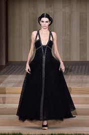 Kendall Jenner looked every inch the queen of the Chanel Couture catwalk in this gorgeous black lace gown with an embellished front and shoulder straps.