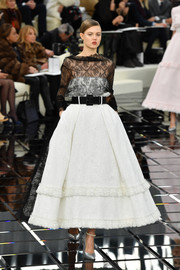 Lindsey Wixson looked like royalty in a black-and-white lace-bodice fit-and-flare dress while walking the Chanel Haute Couture show.