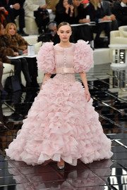 Lily-Rose Depp stepped onto the Chanel Haute Couture runway in an explosion of pink ruffles!