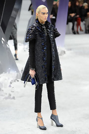A pair of gray cutout boots added to the futuristic feel of Anja Rubik's look.
