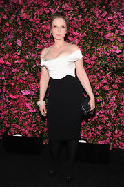 Julie Delpy chose a chic off-the-shoulder dress with a fitted white satin top and black pencil skirt for her elegant look at the Chanel Tribeca Film Festival dinner.