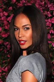 Joan Smalls showed off her pearly whites with a perfectly filled in, red lip.