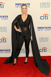Katy Perry attended the Change Begins Within benefit concert looking superhero-ish in a black Yousef Al-Jasmi catsuit with floor-length wing sleeves.