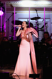Katy Perry performed at the Change Begins Within benefit concert wearing a dramatic pink Alexis Mabille Couture one-shoulder gown adorned with a huge bow.