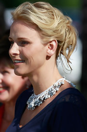Charlene Wittstock wore her hair in a casual updo while attending a charity breakfast in South Africa.