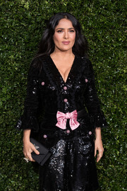Salma Hayek paired a black Bulgari envelope clutch with a sequined dress for the Charles Finch and Chanel pre-BAFTA dinner.