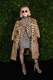 Noomi Rapace went OTT with this all-leopard coat, jacket, dress, tights, and boots combo at the Charles Finch and Chanel pre-BAFTA dinner.