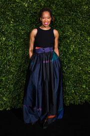 Regina King looked effortlessly glam in a Giorgio Armani gown with a black bodice and a printed ball skirt at the Charles Finch and Chanel pre-BAFTA dinner.