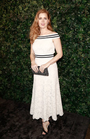 Amy Adams was demure in an off-the-shoulder lace dress by Chanel at the pre-BAFTA party.