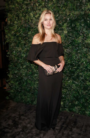 Julia Stiles was a boho babe at the Charles Finch & Chanel pre-BAFTA party in a floaty black off-the-shoulder gown.