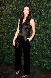 Caitriona Balfe was relaxed yet stylish in a sleeveless black satin jumpsuit by Chanel at the pre-BAFTA party.