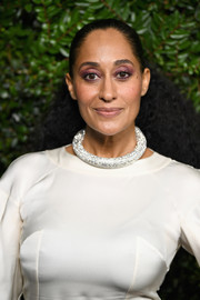 Tracee Ellis Ross sported a half-up 'do that was tight at the top and voluminous and curly down the ends at the Charles Finch and Chanel pre-Oscar dinner.