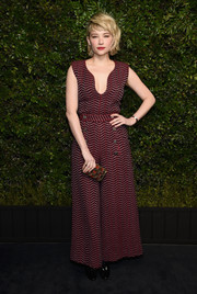 Haley Bennett chose a maroon wide-leg jumpsuit by Chanel for the Charles Finch pre-Oscar dinner.