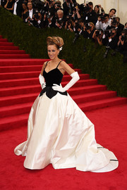 Sarah Jessica Parker went for whimsical glamour at the Met Gala in a black-and-white Oscar de la Renta gown with a voluminous skirt and petal detail along the waist.