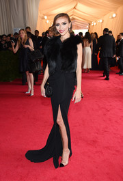 Giuliana Rancic arrived for the Met Gala wearing a black fur vest over her Rhea Costa gown.