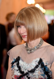 Anna Wintour sported her trademark bob and blunt bangs at the Met Gala. No surprise there.