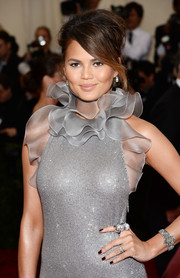 Chrissy Teigen attended the Met Gala wearing a massive pearl ring.