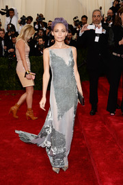 Nicole Richie showed off her super-slim physique at the Met Gala in a gray Donna Karan Atelier column dress featuring velvet and see-through panels and a long train.