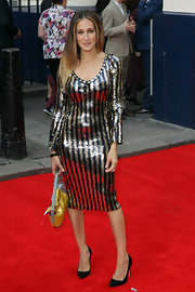 SJP sparkled on the red carpet when she wore this gold and black striped dress.