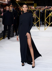 Ella Balinska flashed an eyeful of leg in a high-slit black gown by Prada at the UK premiere of 'Charlie's Angels.'