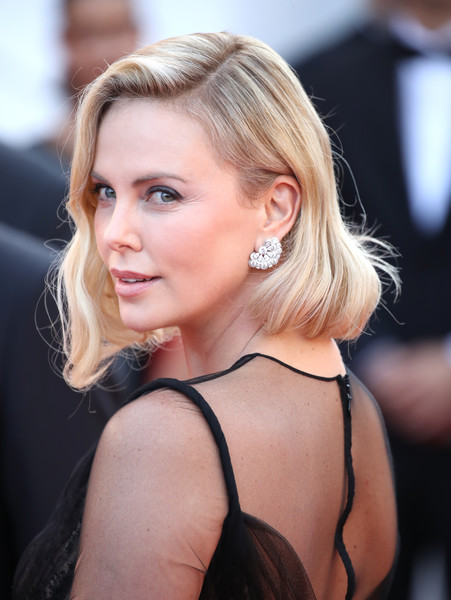 Charlize Theron Diamond Studs [hair,beauty,human hair color,hairstyle,blond,eyebrow,chin,long hair,girl,layered hair,red carpet arrivals,charlize theron,cannes,france,cannes film festival,palais des festivals]