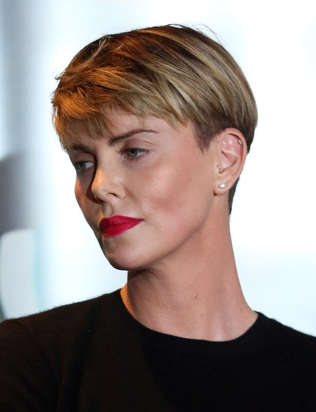 Charlize Theron Red Lipstick [hair,face,hairstyle,chin,lip,eyebrow,blond,beauty,head,cheek,charlize theron,sls hotel,beverly hills,california,geanco foundation hollywood gala - arrivals,geanco foundation hollywood gala]
