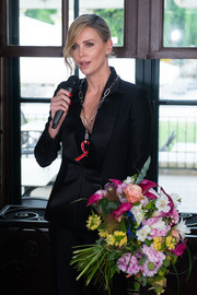 Charlize Theron attended the Swarovski Crystal of Hope award ceremony wearing a perfectly tailored black jacket.