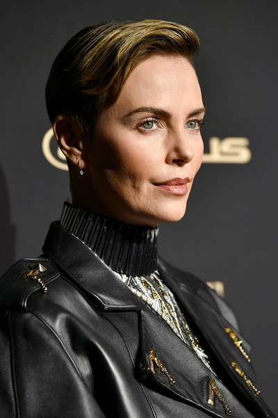 Charlize Theron Boy Cut [hair,hairstyle,beauty,lady,fashion,lip,leather,fashion model,jacket,model,lexus - arrivals,26th annual women in hollywood celebration,ralph lauren,charlize theron,los angeles,beverly hills,california,the four seasons hotel,elle,lexus]