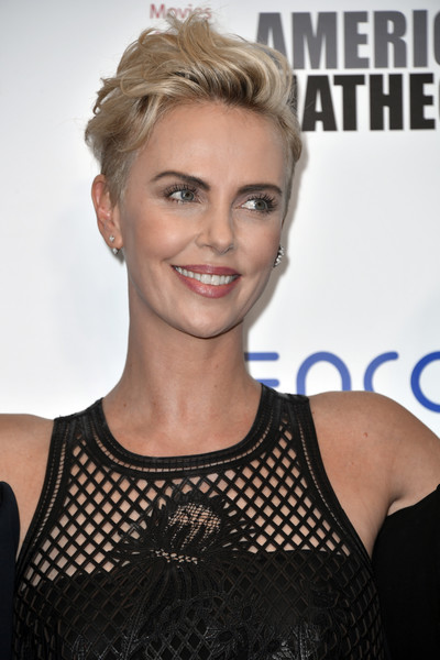 Charlize Theron Fauxhawk [hair,face,hairstyle,blond,eyebrow,beauty,chin,skin,lip,brown hair,charlize theron,photo op,beverly hills,california,the beverly hilton hotel,american cinematheque award presentation]
