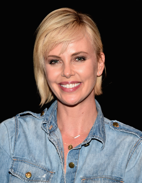 Charlize Theron Short Cut With Bangs [2 days in the valley,hair,face,blond,hairstyle,chin,eyebrow,lip,smile,denim,textile,charlize theron,neuehouse hollywood,california,los angeles,reunion,reunion]
