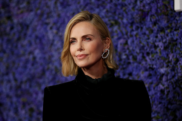 Charlize Theron Short Side Part [hair,face,blue,electric blue,cobalt blue,beauty,blond,purple,hairstyle,fashion,caruso,charlize theron,palisades village,pacific palisades,california,gala,palisades village opening gala,arrivals]