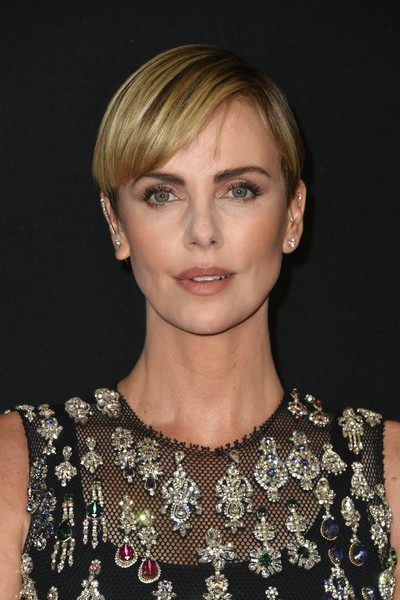 Charlize Theron Short Side Part [hair,face,hairstyle,blond,eyebrow,shoulder,lip,beauty,chin,fashion,the beverly hilton hotel,beverly hills,california,annual hollywood film awards - arrivals,charlize theron]