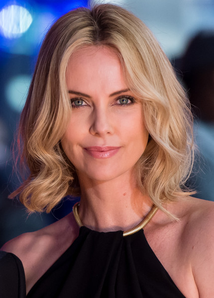 Charlize Theron Short Wavy Cut [the gunman,hair,face,blond,hairstyle,eyebrow,beauty,chin,layered hair,long hair,brown hair,red carpet arrivals,charlize theron,england,london,bfi southbank,world premiere]