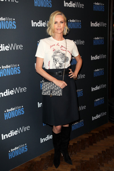 Charlize Theron Printed Shoulder Bag [clothing,dress,fashion,footwear,joint,event,premiere,cocktail dress,boot,knee,indiewire honors 2018,no name,los angeles,california,charlize theron]